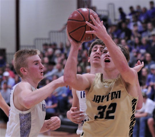 Jayton's Tye Scogin (32) shoots over the Irion County defense of Trevin Coffell (left). Jayton won the Region II-1A semifinal game 43-31 on Friday, March 6, 2020, at McMurry's Kimbrell Arena in Abilene.