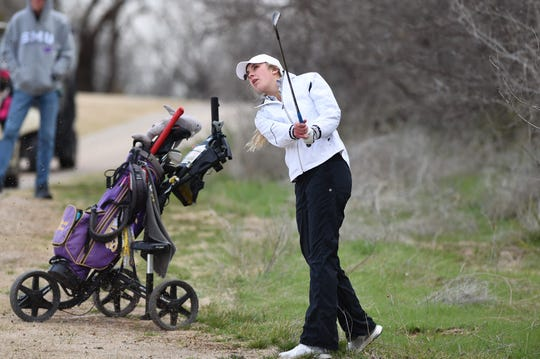 Wylie's Maddi Olson hits her second shot on No. 1 during the second round of the AHS Lady Eagle Invitational at the Diamondback Golf Club in Abilene. Olson won the tournament with a two-round score of 140 after shooting a 66 on Saturday.