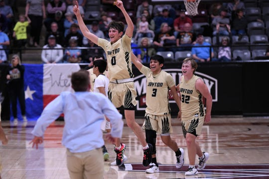 Jayton's Tripp Scott (0), Aaron Hernandez (3) and Tye Scogin (32) celebrate winning the Region II-1A final 49-36 against Paducah at McMurry's Kimbrell Arena on Saturday. The victory sends the Jaybirds to a second-straight Class 1A state tournament.