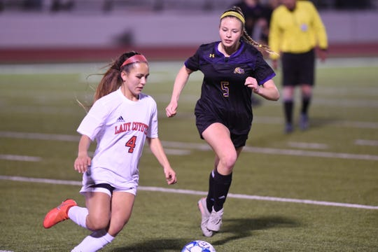 Wylie's Marianna Deynzer (5) chases down a Wichita Falls High player and the ball during Friday's game at Bulldog Stadium.