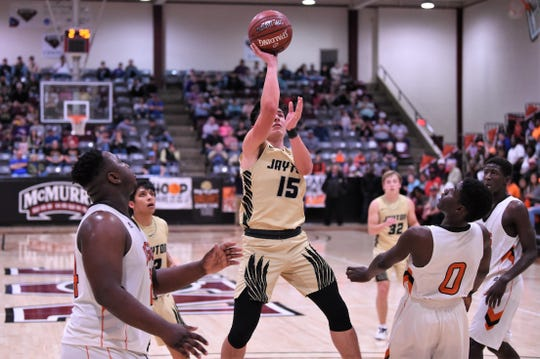 Jayton's Pecos Smith (15) takes a shot during the Region II-1A final against Paducah at McMurry's Kimbrell Arena on Saturday, March 7, 2020. The Jaybirds won 49-36 to reach a second-straight Class 1A state tournament.