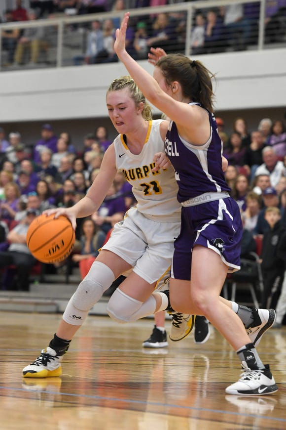 Murphy's Torin Rogers attempts to push past Mitchell's Marley Cloer during the NCHSAA 1A West regional final game at Catawba Valley Community College on March 7, 2020.
