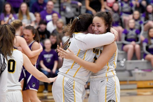 Murphy's Amber Martin wraps Mia Wilson in a hug after the Lady Bulldogs defeated Mitchell 63-62 in the NCHSAA 1A West regional final game to advance to the state championship at Catawba Valley Community College on March 7, 2020.