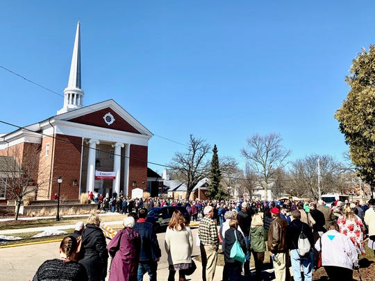 Delegates get ready to enter the special session of Michigan annual conference for the United Methodist Church held at Albion College's Goodrich Chapel.