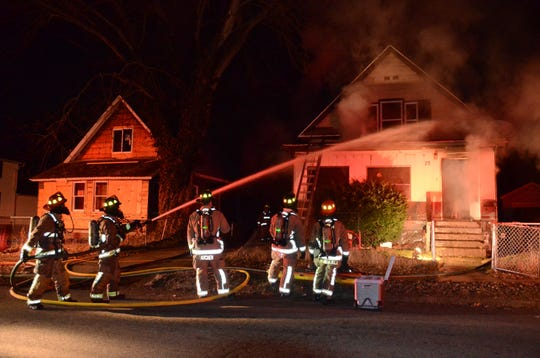 Battle Creek firefighters battle a blaze at 75 Frisbie Avenue early Saturday, March 7, 2020.