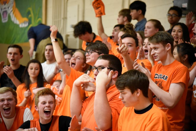 The Calhoun Christian student section cheers during halftime of a Division 4 district final at St. Philip Catholic Central High School on Friday, March 6, 2020.