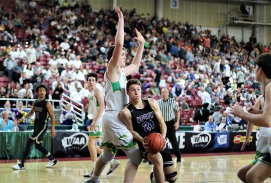 North Kitsap's Logan Chmielewski drives to the basket around Lynden's Liam Hanenburg.