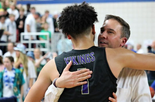 North Kitsap boys basketball coach Scott Orness hugs senior Shaa Humphrey after Friday's 62-56 win over Lynden in the Class 2A state semifinals.