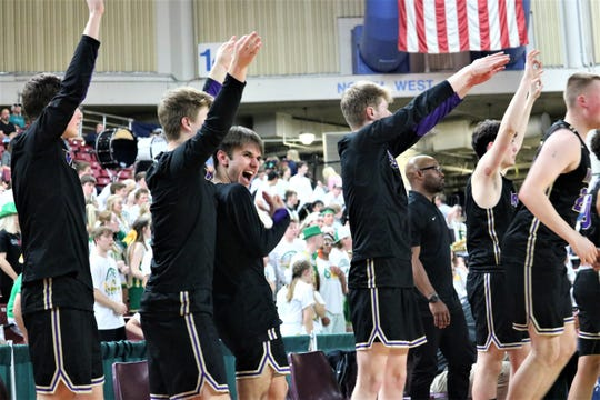 North Kitsap's bench players celebrate during the fourth quarter of Friday's win against Lynden.