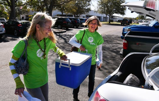 Joyce Owens and Nancy Flemming load meals into their car during Florida Power & Light Company's annual Power to Care Day. On March 7, volunteers worked alongside Brevard County nonprofits Meals on Wheels and Aging Matters to deliver lunch to homebound seniors in the Melbourne area.