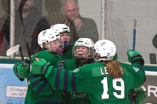 Burlington/Colchester players celebrate a goal by Brynn Coughlin, center, during a Division I high school girls hockey semifinal at Leddy Park on Friday, March 6, 2020.