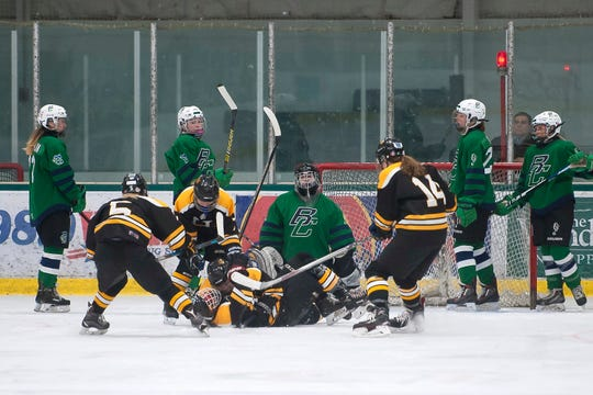Harwood players celebrate scoring the opening goal against Burlington/Colchester during a Division I high school girls hockey semifinal at Leddy Park on Friday, March 6, 2020.