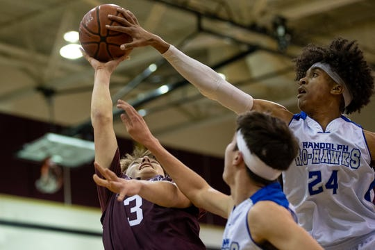 London's Preston Cazalas has his shot blocked by Randolph's Thyrell McCline during the first quarter of the regional semifinal Seguin High School on Friday, March 6, 2020.