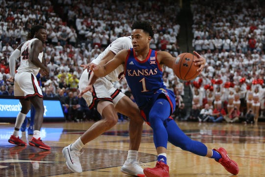 Mar 7, 2020; Lubbock, Texas, USA;  Kansas Jayhawks guard Devon Dotson (1) drives to the basket against the Texas Tech Red Raiders in the first half at United Supermarkets Arena. Mandatory Credit: Michael C. Johnson-USA TODAY Sports