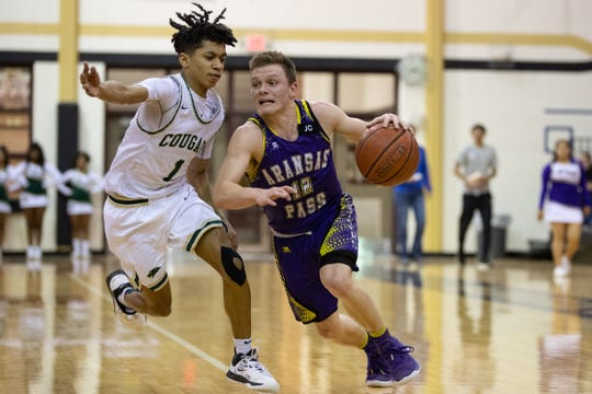 Aransas Pass junior James Crawford drives against San Antonio Cole's Silas Livingston in the Class 3A boys regional semifinals on Friday, March 6, 2020 in Seguin.