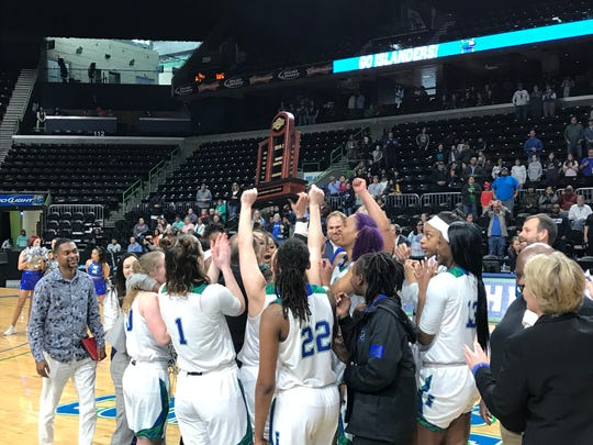 The Texas A&M-Corpus Christi women's basketball team hoists the Southland Conference regular season championship trophy after beating Houston Baptist 58-47 at the American Bank Center on Saturday, March 7, 2020.