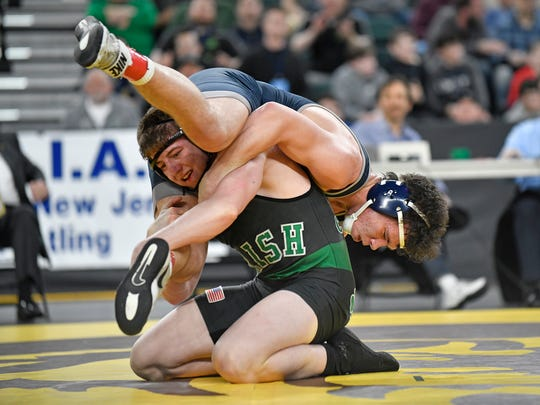 Martin Cosgrove of Camden Catholic, left, defeats Mike Misita of St. Augustine Prep in the 195 lb. semifinal bout during the NJSIAA state individual wrestling tournament at Boardwalk Hall in Atlantic City on Friday, March 6, 2020.