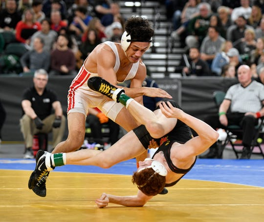 Jacob Perez-Eli of Paulsboro, left, and William Grater of Bergen Catholic wrestle during the 138 lb. semifinal bout during the NJSIAA state individual wrestling tournament at Boardwalk Hall in Atlantic City on Friday, March 6, 2020.