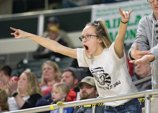 Haynna Addy celebrates in the Ohio University Convocation Center after Zane Trace scored against Ironton. The Zane Trace boys' basketball team defeated Ironton 51-41 Friday night in a Division III District Finals game at the Ohio University Convocation center in Athens, Ohio, on March 6, 2020.