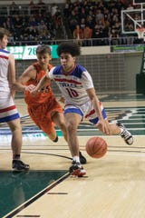 Zane Trace senior Cam Evans drives the ball past an Ironton player in a Division III District Finals game. The Zane Trace boys' basketball team defeated Ironton 51-41 Friday night in a Division III District Finals game at the Ohio University Convocation center in Athens, Ohio, on March 6, 2020.