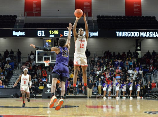 Hasaan Wilson of Hughes shoots a jumper against Thurgood Marshall during the OHSAA playoffs at the University of Cincinnati, Friday, March 6, 2020.