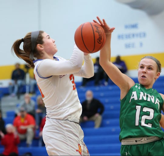 Purcell Marian's Kara King (30) drives to the basket against Anna's Michaela Ambos (12) during their regional final, Saturday, March 7, 2020.
