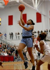 Mount Notre Dame guard Makira Cook drives to the basket during their regional final against Kettering Fairmount, Saturday, March 7, 2020.