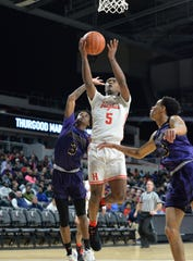 Kionte Thomas of Hughes shoots the ball against Thurgood Marshall during the OHSAA playoffs at the University of Cincinnati, Friday, March 6, 2020.