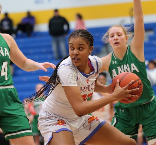 Purcell Marian's Jana Rose (23) grabs a rebound during their regional final against Anna, Saturday, March 7, 2020.