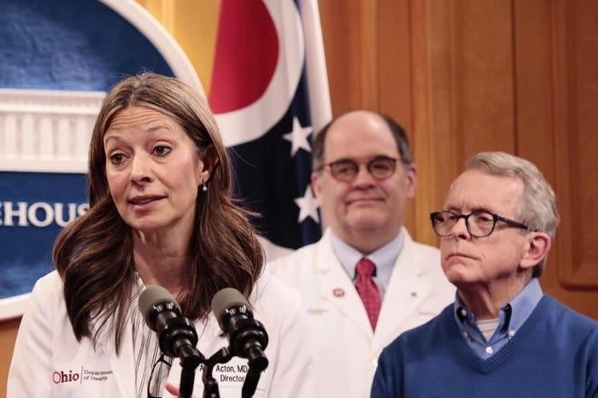 Dr. Amy Acton, left, director of the Ohio Department of Health, answers questions during a press conference regarding the state's response and testing plans for COVID-19 on Saturday, March 7, 2020, at the Ohio Statehouse in Columbus, Ohio.