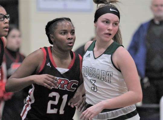 Brossart junior Rosie Jump battles for position with GRC senior Shelbi Wilson as Bishop Brossart lost 47-44 to George Rogers Clark in the semifinals of the KHSAA 10th Region girls basketball tournament March 6, 2020, at Campbell County Middle School, Alexandria, Ky.