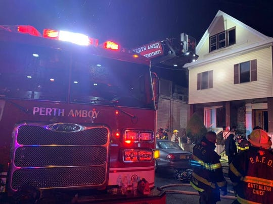 Perth Amboy  firefighters  respond to a fire Friday on Market Street.