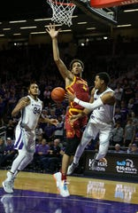 Mar 7, 2020; Manhattan, Kansas, USA; Kansas State Wildcats guard David Sloan (4) passes the ball around Iowa State Cyclones forward George Conditt IV (4) during the first half of a game at Bramlage Coliseum. Mandatory Credit: Scott Sewell-USA TODAY Sports