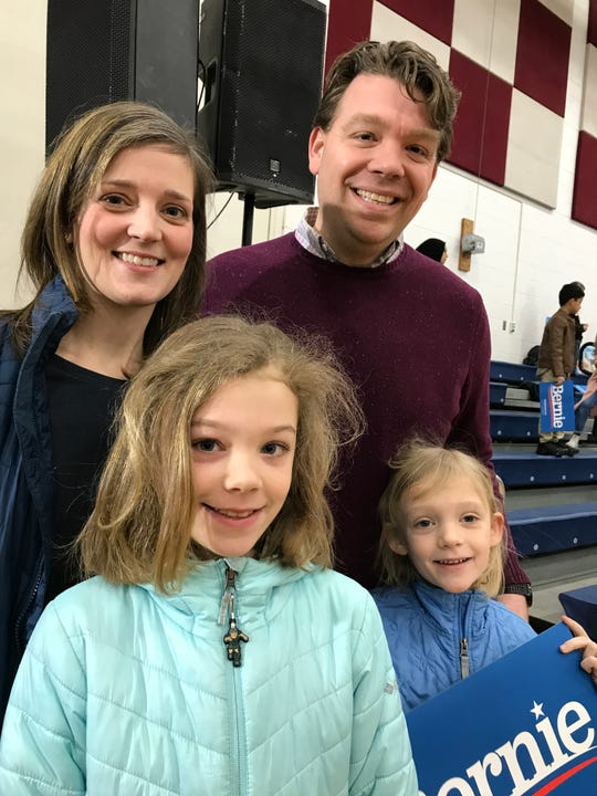Chris Stanley, 37, of Grosse Pointe Woods (upper right) attended Bernie Sanders' rally in Dearborn on March 7, 2020, with his wife Katie (left) and their daughters Mae, 9, and Hazel, 7.