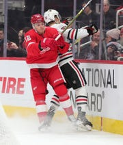 Detroit Red Wings left wing Dmytro Timashov (15) checks Chicago Blackhawks defenseman Nick Seeler (55) during first period action Friday, March 6, 2020 at Little Caesars Arena in Detroit, Mich.