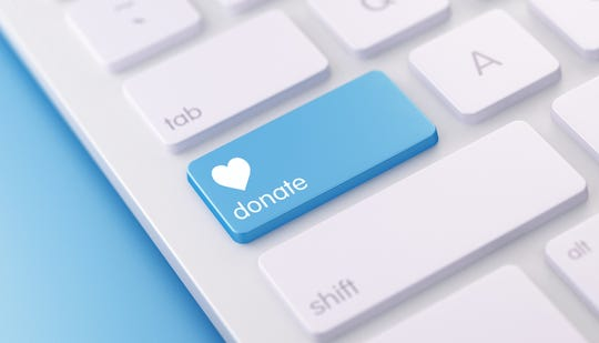 White keyboard with blue colored Donate button