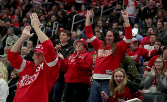 Fans celebrate after a goal by Detroit Red Wings center Robby Fabbri (14) during second period action against the  Chicago Blackhawks Friday, March 6, 2020 at Little Caesars Arena in Detroit, Mich.