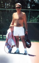 Theodore Walling of West Bloomfield poses in this undated tennis photo with his son, Brandon, who is now 25. Walling, 65, was found stabbed to death in his hotel room in Jamaica on Wednesday, March 4, 2020.