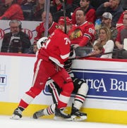 Detroit Red Wings defenseman Madison Bowey (74) checks a Chicago Blackhawks defender during second period action Friday, March 6, 2020 at Little Caesars Arena in Detroit, Mich.