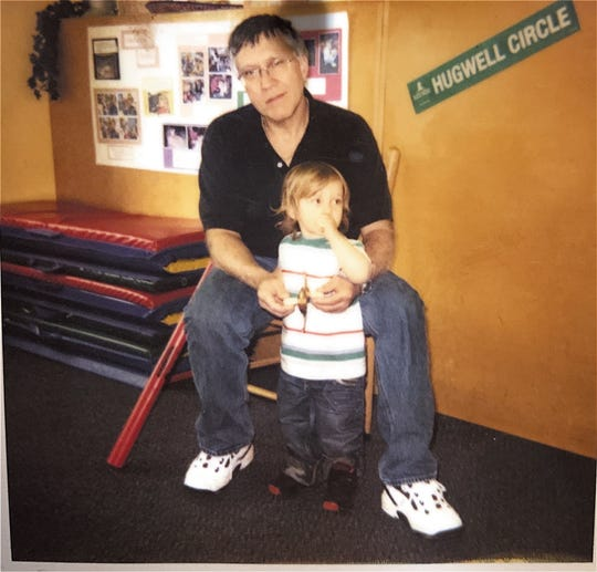 Theodore Walling of West Bloomfield holds his youngest son, Josh, now 14, in this undated photo. Walling, 65, was found stabbed to death in his hotel room in Jamaica on Wednesday, March 4, 2020.