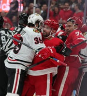 Detroit Red Wings center Sam Gagner (89) holds off Chicago Blackhawks defenseman Dennis Gilbert (39) during second period action Friday, March 6, 2020 at Little Caesars Arena in Detroit, Mich.