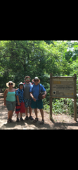 Theodore Walling of West Bloomfield poses with his two sons and wife in a photo taken during a 2016 family trip to Colombia. Walling, 65, was found stabbed to death in his hotel room in Jamaica on Wednesday, March 4, 2020.
