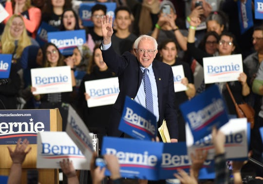 Presidential candidate Bernie Sanders waves to a large crowd during a campaign stop at Salina Intermediate School in Dearborn on Saturday.
