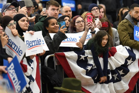 Supporters of Presidential candidate Bernie Sanders listen and take photographs during a campaign stop for Sanders at Salina Intermediate School in Dearborn on Saturday, March 7, 2020.