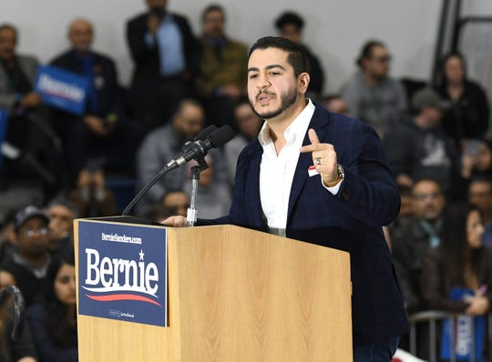 Abdul El-Sayed speaks about his candidate for president, Bernie Sanders, during a Sanders campaign rally at Salina Intermediate School in Dearborn on Saturday.
