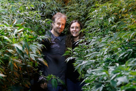 Chip and Jessica Baker pose for a photo at their marijuana nursery at Baker's Medical, Wednesday, Feb. 26, 2020, in Oklahoma City.