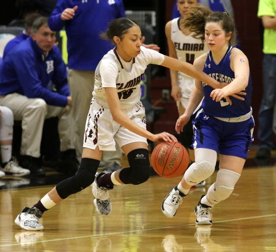 Elmira's Jalea Abrams is defended by Horseheads' Carly Scott during the Express' 70-50 win in the Section 4 Class AA girls basketball championship game March 6, 2020 at Elmira High School.