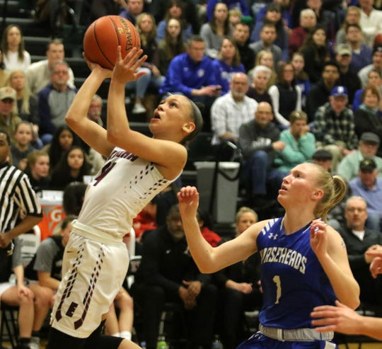 Kiara Fisher of Elmira drives for a shot in front of Kellie Zoerb of Horseheads during the Express' 70-50 win in the Section 4 Class AA girls basketball championship game March 6, 2020 at Elmira High School.