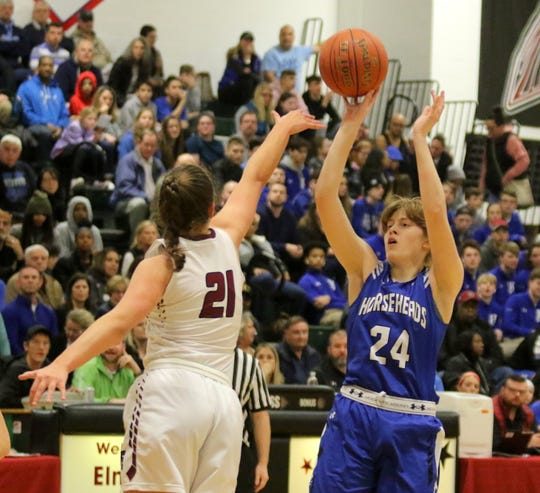 Jillian Casey of Horseheads takes a shot as Elmira's Morgan Gentile defends during the Express' 70-50 win in the Section 4 Class AA girls basketball championship game March 6, 2020 at Elmira High School.