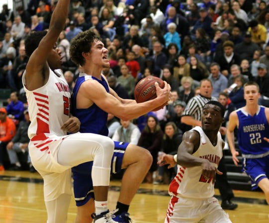 Grayson Woodhouse of Horseheads drives to the hoop as Binghamton's Tyreese Rowe (left) and Jarrid Kirkland defend during the Patriots' 84-82 overtime win in the Section 4 Class AA boys basketball championship game March 6, 2020 at Elmira High School.
